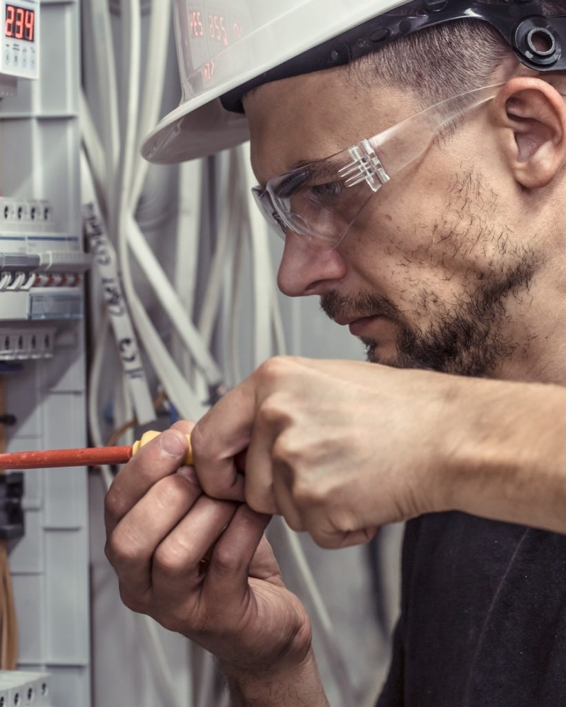 a-male-electrician-works-in-a-switchboard-with-an-electrical-connecting-cable.jpg